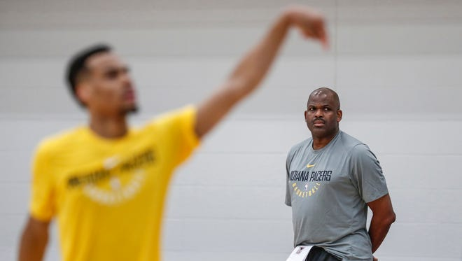 As Indiana Pacers head coach Nate McMillan watches on, France's Elie Okobo shoots during an NBA pre-draft workout for the Indiana Pacers at the St. Vincent Center on Tuesday, June 19, 2018.