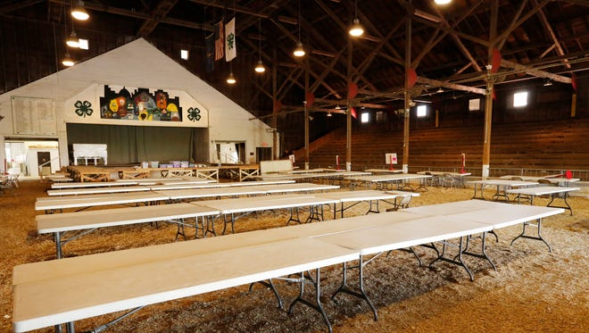 Folding tables fill the coliseum Wednesday, July 18, 2018, at the Tippecanoe County Fairgrounds. The Tippecanoe County 4-H Fair is next week.