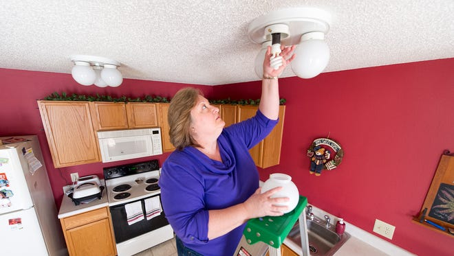 Kathy Burkhart had her home analyzed by the Energizing Indiana program in 2012 and since that time has made use of many of the items given to her — lightbulbs, faucet attachments, and more.