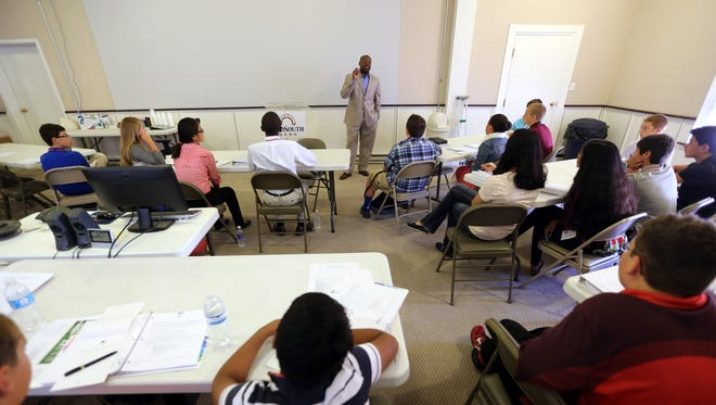 First Baptist Church Pastor James McCarroll has served as a speaker for middle-schoolers attending the State Farm Business Camp
