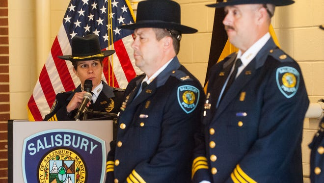 Salisbury police Chief Barbara Duncan begins a promotion ceremony for eleven members of the force at the Salisbury Police Station on Friday afternoon.