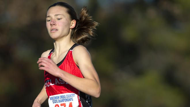 Pulaski's Kailyn Jessel runs toward the finish line during 2014 State Cross Country Championships at the Ridges Country Club in Wisconsin Rapids, Saturday, Nov. 1, 2014.
