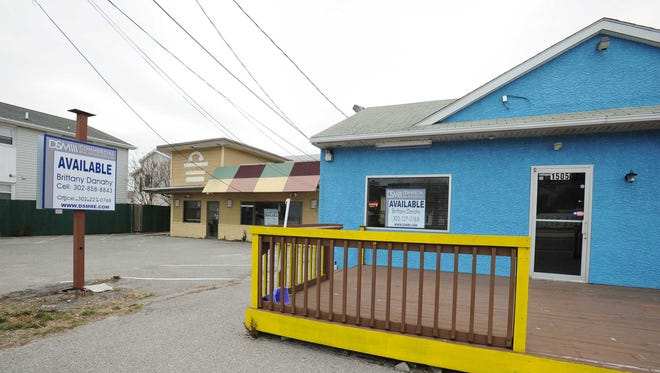 Two buildings on Coastal Highway in Dewey Beach that the town is purchasing are shown on Wednesday. Residents are challenging the $875,000 land acquisition.
