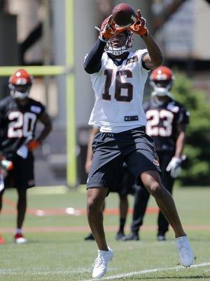 Cincinnati Bengals wide receiver Cody Core (16) catches a pass during Cincinnati Bengals organized team activities, Tuesday, May 23, 2017, on the practice fields next to Paul Brown Stadium in Cincinnati.