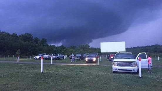 This photo taken at Stardust Drive-in Theatre in Watertown shows a large storm cloud on Friday night. A tornado touched down 2 miles north of Watertown in Wilson County.