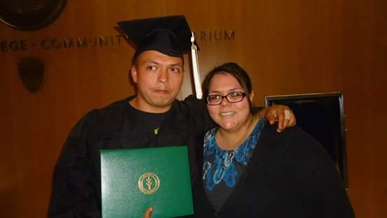 Hector Cedillo Jr., at his Ivy Tech Community College graduation, with his sister.