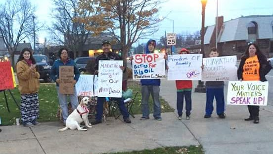 Protesters opposing the Dakota Access Pipeline hold signs outside the Marathon County Courthouse on Oct. 28.