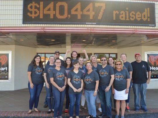 A 2017 file photo shows Springfield-based iHeartMedia staff and Ozarks Food Harvest volunteers.