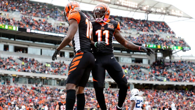 Cincinnati Bengals wide receiver A.J. Green (18) and Cincinnati Bengals wide receiver Brandon LaFell (11) celebrate Green's touchdown reception in the second quarter of the NFL Week 8 game between the Cincinnati Bengals and the Indianapolis Colts at Paul Brown Stadium in downtown Cincinnati on Sunday, Oct. 29, 2017.