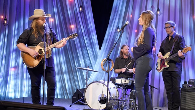 "Chris and Morgane Stapleton perform during pre-taping for ""Dolly Parton's Smoky Mountains Rise: A Benefit for the My People Fund"" Tuesday Dec. 13, 2016, in Nashville, Tenn."