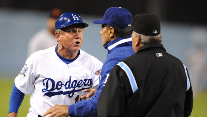 Larry Bowa, left, shown here during his tenure as Dodgers third base coach in 2008, managed the Padres in 1987-88 and the Phillies from 2001-2004.