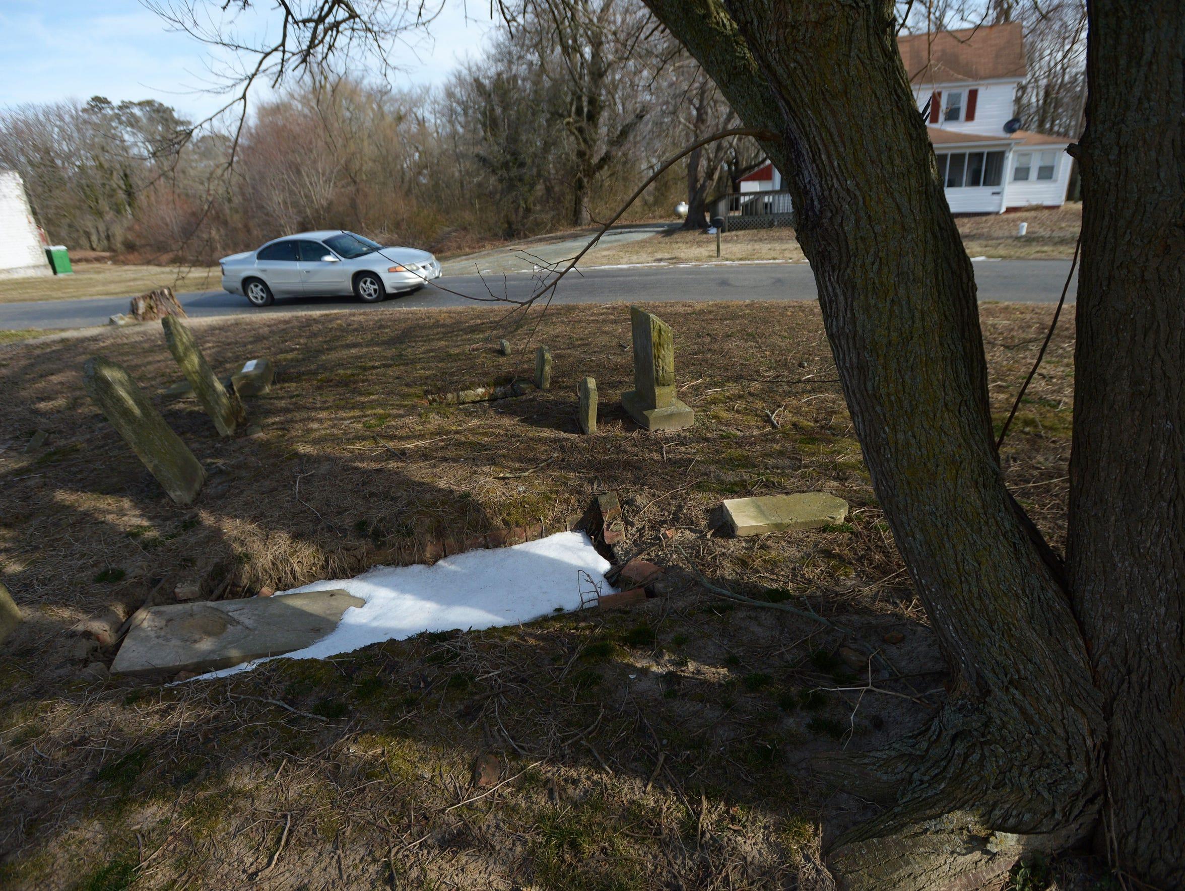 A car passes the small Mason family cemetery plot on
