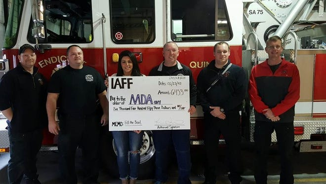 From left, Chris Sampson, Dan Williams, Kristen Lemaire, Dave Abell, Matt Griswold and Dave Stokes raised money for the Muscular Dystophy Association on Black Friday.