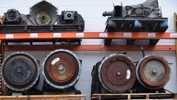 Pictured stock-pile of truck and automobile transmissions on the premises. Dennis Galloway owner of DG and Sons in Rochelle Park at , located at 162 Central Avenue, gave a tour of his new location to Timothy J. Lizura the CEO of the EDA, Giovanni Mazzei M&T Bank VP Business & Professional Banking. The company was able to move into a 16,000-sq-ft facility through a loan in participation with the EDA's small business fund in Rochelle Park NJ, March 7, 2017.