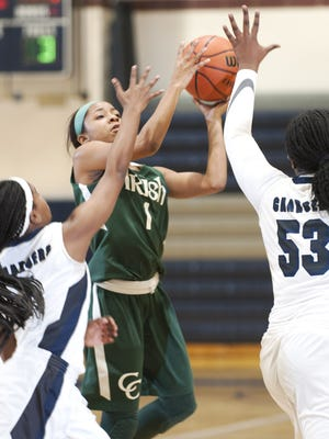 Camden Catholic's Taiah Thornton, center, shoots between Timber Creek's Fatimah Williams, left, and Timber Creek's Jazmine Carter, right, during the 1st quarter of Thursdays girls basketball game played at Timber Creek High School.  01.07.16