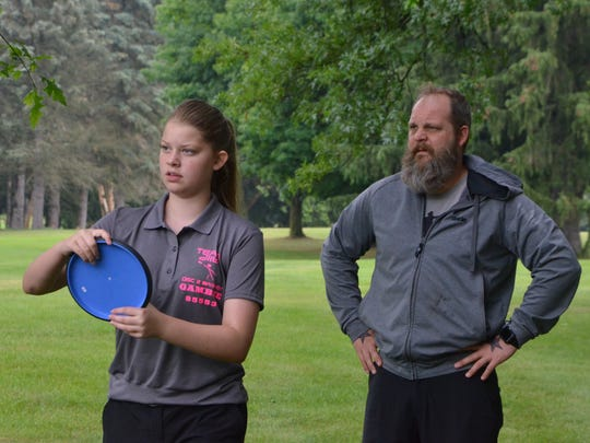 Kasey Gambee and her father, Travis Gambee, discuss