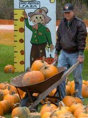 Jim Klug moves a load of pumpkins in preparation for