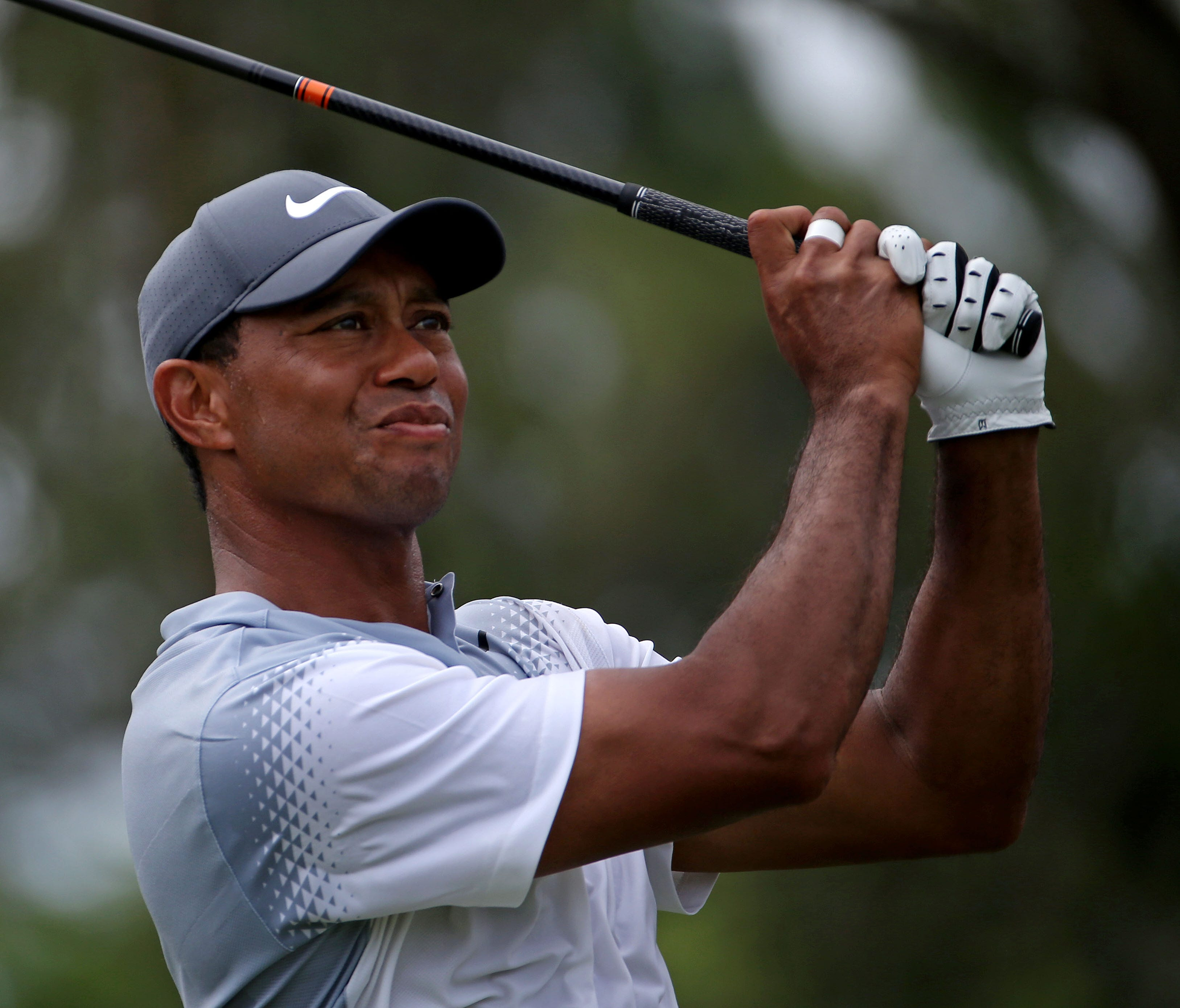Tiger Woods plays his shot from the ninth tee during the third round of The Players Championship on the Stadium Course at TPC Sawgrass in Ponte Vedra Beach, Fla.