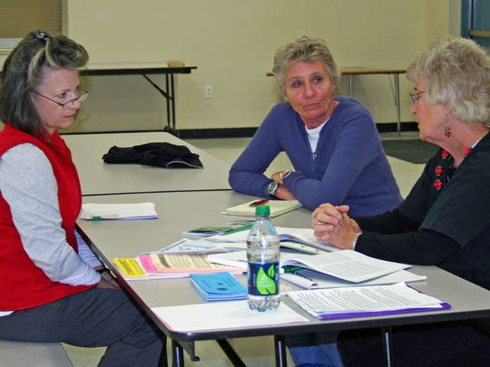 Two potential tutors for the ESL In-Home Program of Northern Nevada meet with local tutor Donna McElroy to learn how they can help make a difference in the community. Jenny Dodds (left) Allison Wiliams (right) and tutor Donna McElroy chat about the simple principles of the ESL program.