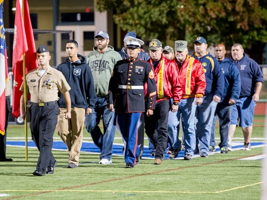 Chambersburg honors past and present military men and women during halftime on Friday, Oct. 14, 2016, at Trojan Stadium.