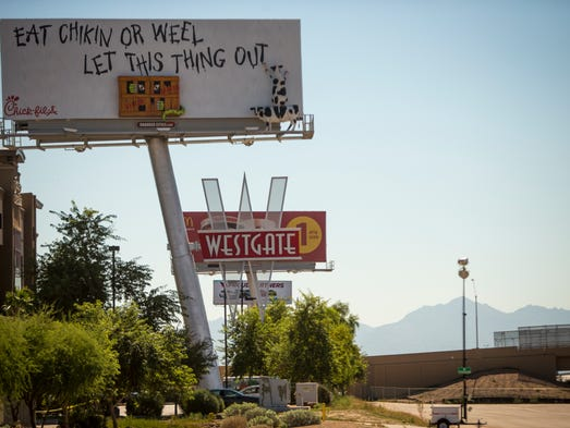A billboard company wants to put up large billboard