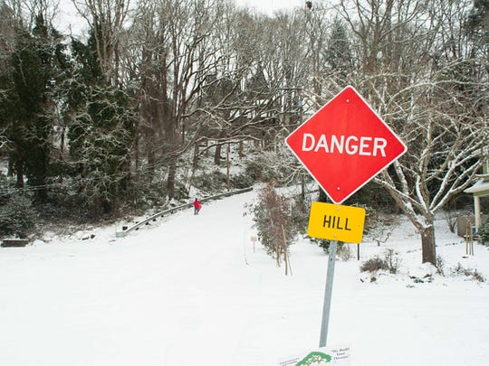 When the snow falls, Silverton's East Main Street Hill, known locally as Danger Hill, become a favorite sledding spot. FOR STATESMAN JOURNAL and APPEAL TRIBUNE USE ONLY.