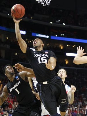 Jalen Reynolds (left) and Myles Davis (middle) are two key pieces of the puzzle for Xavier next season. They helped the Musketeers this year to the Big East Championship game and the NCAA tournament's Sweet 16.