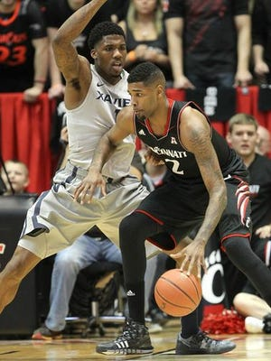 Jalen Reynolds (left) and Xavier host Octavius Ellis and UC at 5:30 p.m. Saturday at Cintas Center. Both teams are ranked in the Top 25.