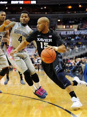 Georgetown's D'Vauntes Smith-Rivera (left) and Xavier's Myles Davis meet again at 8:30 p.m. Tuesday at Cintas Center. XU went 3-0 against the Hoyas last year, including this 66-53 victory at the Verizon Center.