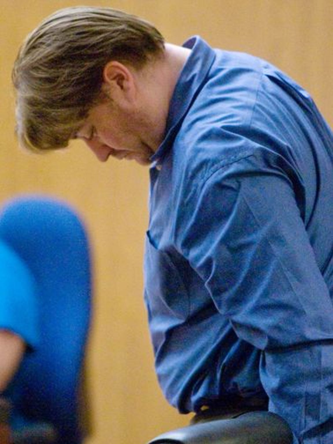 Sam Dieteman looks down during court shortly after