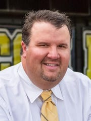 Hendersonville golf coach Andy Gilley