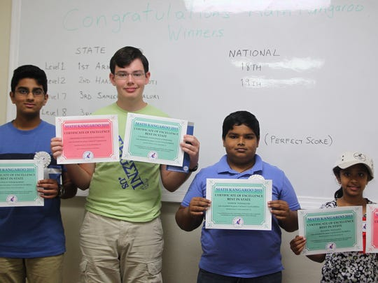 Local winners of Math Kangaroo, an international math competition pose together with their certificates; from left, Venkat Kommu, Graham O'Donnell, Sameer Ponnaluri and Hassini Yelugoti.