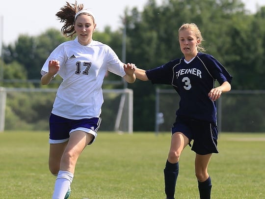 Kelly Abraham (No. 17) chases the ball during Thursday's