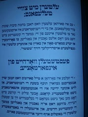 A flier posted on the synagogue wall warns parents
