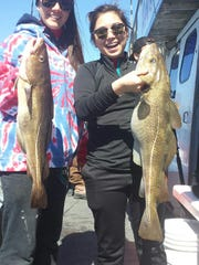 Kayla Taylor (left) and Emily Mowen, both of Manasquan with a pair of codfish caught on the Dauntless.