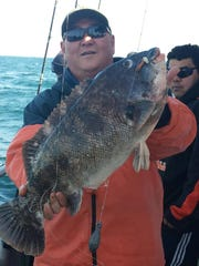 Ray Cha of New Hope, Pennsylvania with a 12-pound blackfish he caught on the Dauntless.