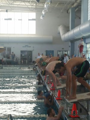 Kylar Woolston prepares to dive in on the 100 meter free style.
