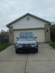Gregory D. Harris sent CastleRock REO this photo of his BMW parked in the driveway of a home he is accused of moving into without authorization. The SUV was reported stolen.