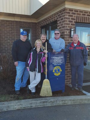Chambersburg Evening Lions show off their latest used eyeglass collection box.