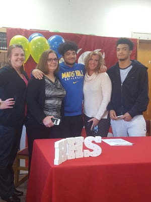 Hendersonville senior Leon Cooks has signed to play college football for Mars Hill.