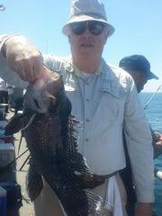 Donald Finan, Toms River, with a five-pound sea bass that won the boat pool on the party boat Dauntless.