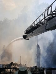 A remote controlled hose at the tip of the truck empties water on the last of the flames.