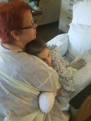 Becky Bent-Weible hugs her daughter, Airionna Bent,