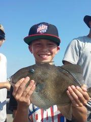 Caleb Criscitello, of Clarksburg, with a 4-pound triggerfish