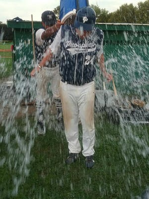East Prospect manager Mark Toomey is dunked with water after one of his team's recent championships.