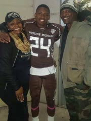 (From left) Carol, Obbie and Big Obbie Jackson at a Western Michigan football game.