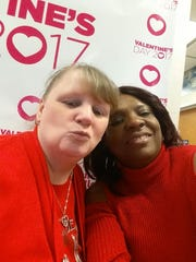 Manager Lola Brock and General Manager Priscilla Uba at last year's White Castle Valentine's Day event in Flanders.