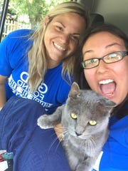 Kayla Denney (left) and Aleea Best (right), Vet Tech at PAAC take a photo with Johnny.