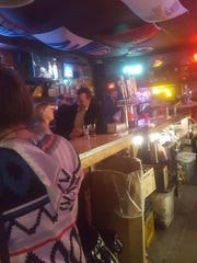 Cell phone photos show Sen. Bill Dix spending time with a female lobbyist at the Waveland Tap in Des Moines. Dix resigned after video showed him kissing the woman at the bar.