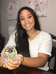 Caylee English and her pet hedgehog Bernard.